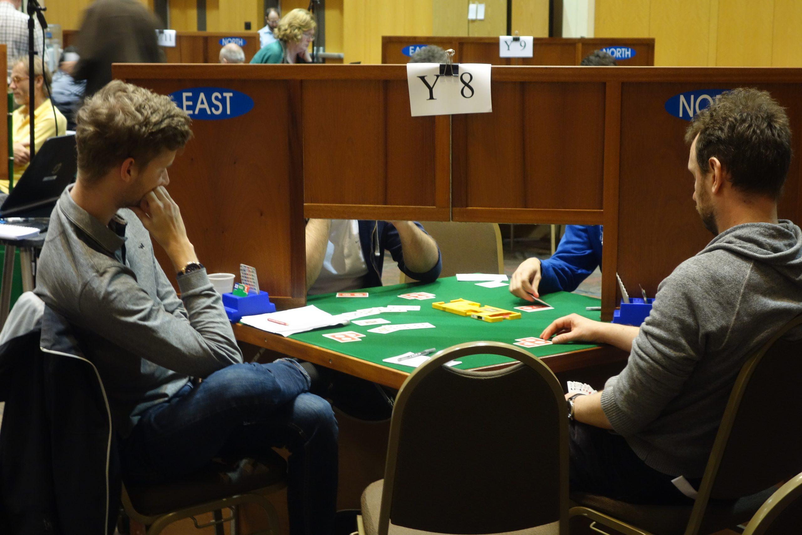 Bridge players competing behind screens